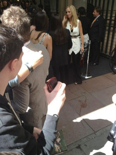 Candice Accola wallpaper with a business suit and a street titled Candice meeting fans at the CW upfronts - 17th May 2012.