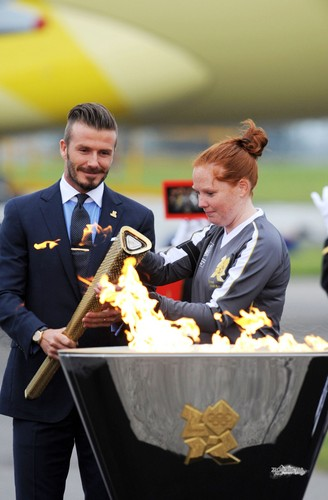 David With The Лондон 2012 Olympic Games Flame At Royal Naval Air Station