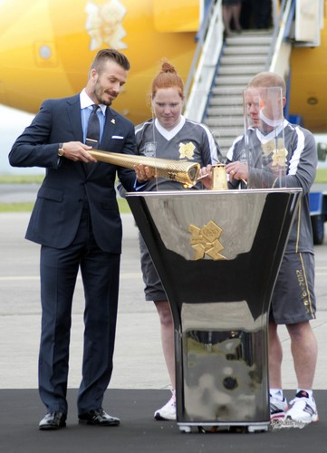 David With The London 2012 Olympic Games Flame At Royal Naval Air Station