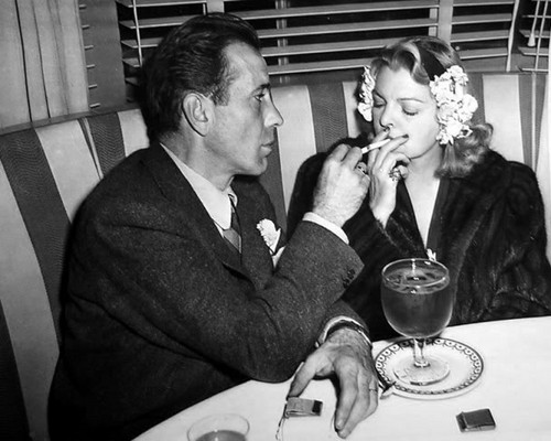 Humphrey Bogart wallpaper containing a business suit titled Humphrey Bogart & Mayo Methot