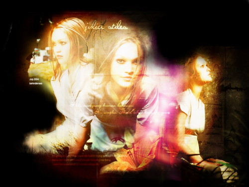 Julia Stiles wallpaper possibly containing a concert and a fire entitled Julia Stiles