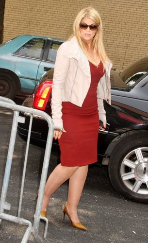 Kirstie Alley wallpaper probably with bare legs, a business suit, and a hip boot entitled Kirstie Alley at 'The Wendy Williams Show' 2011