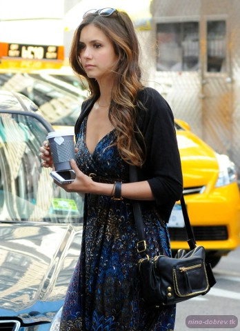 Nina Dobrev wallpaper possibly with a cocktail dress, a street, and a hip boot entitled Nina walking in NYC