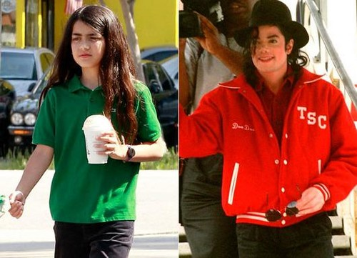 Spitting afbeeldingen Blanket and his father Michael Jackson