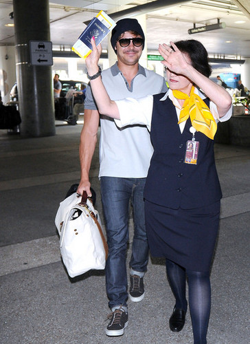 Zac Efron wallpaper probably containing a street, a business suit, and an automobile entitled At Lax 22/05/2012