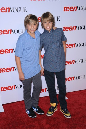 The Sprouse Brothers achtergrond containing a well dressed person and a sign entitled Cole and Dylan Sprouse @ Teen Vogue Young Hollywood Party, 18 Sep 2008