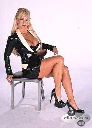 Frühere WWE-Diva… Debra Hintergrund containing bare legs, hosiery, and a hip boot titled Debra