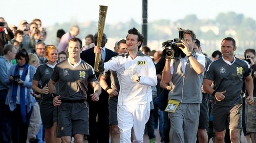 Matt Smith carry the Olympic Torch
