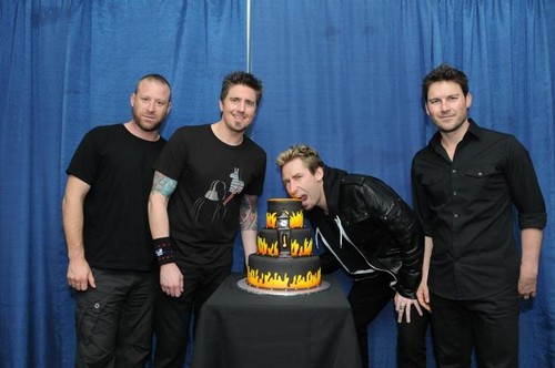 Nickelback posing with a cake - nickelback Photo