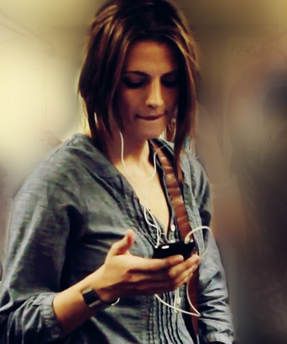 Stana Katic achtergrond containing a portrait titled Stana