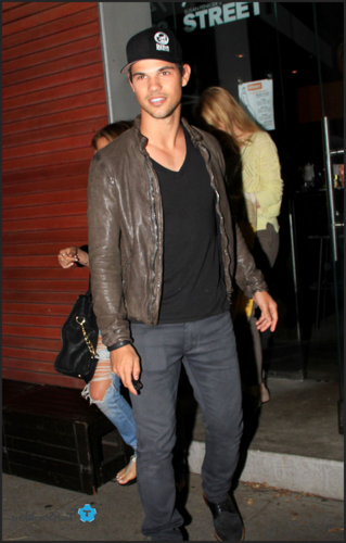 Taylor Lautner wallpaper containing a hip boot, a street, and an outerwear entitled Taylor - Out and about in Hollywood - April 30, 2012