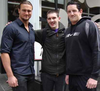 Wade Barrett and Drew McIntyre with a fan