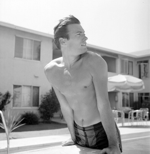 Clint Eastwood wallpaper containing a hunk, swimming trunks, and a six pack entitled shirtless Clint Eastwood