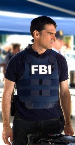 SSA Aaron Hotchner wallpaper with a bulletproof vest titled Aaron Hotchner