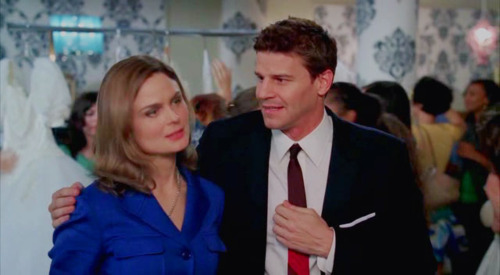 Booth and Bones wallpaper with a business suit and a suit called B&B
