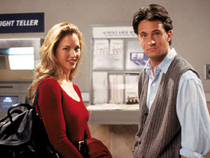 Друзья Обои with a business suit and a well dressed person called Chandler and Jill Goodacre