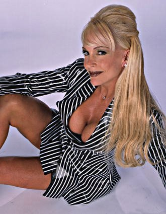 Former WWE Diva... Debra wallpaper containing a leotard titled Debra - Striped Suit