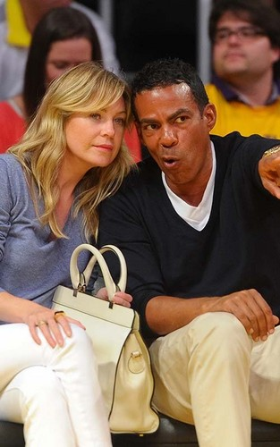 Ellen with her husband watch the Los Angeles Lakers