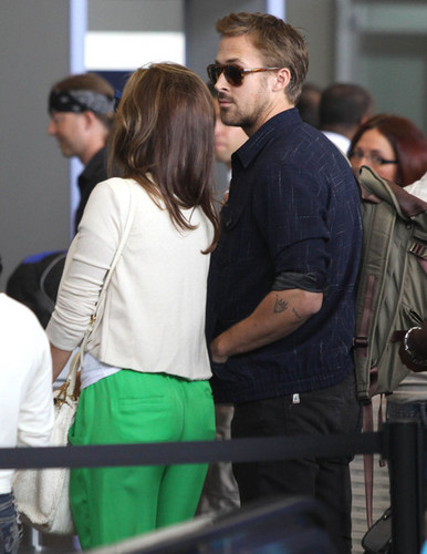 Eva - and Ryan Gosling arriving for a flight at LAX airport in Los Angeles, June 02, 2012
