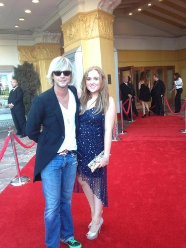 Keith Harkin Hintergrund probably with a well dressed person, long trousers, and a business suit titled Keith and Rebecca