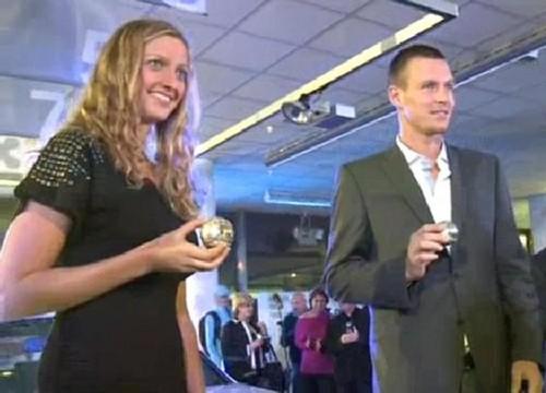 Kvitova and Berdych smile..