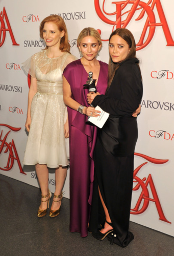 Mary-Kate & Ashley Olsen wallpaper possibly with a well dressed person, a business suit, and a cocktail dress called Mary-Kate & Ashley Olsen - 2012 CFDA Fashion Awards - Winners Walk, June 04, 2012