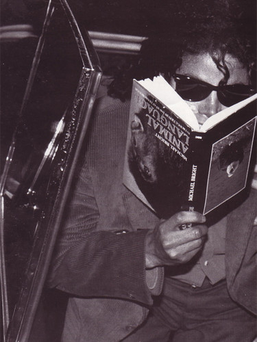 Mikey baby . . . you do know the books upside down, don't you? O.o