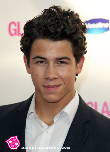 Nick Jonas karatasi la kupamba ukuta with a business suit and a suit entitled nick jonas