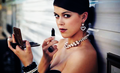Lindsey Shaw putting on make up