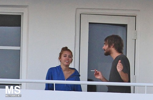 12/06 On The Balcony Of Her Hotel In Miami, Florida - miley-cyrus Photo