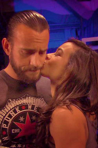Cm punk and Aj Lee wallpaper probably with a portrait entitled Aj kisses Punk