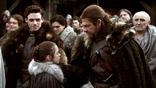 Arya with Robb and Eddard