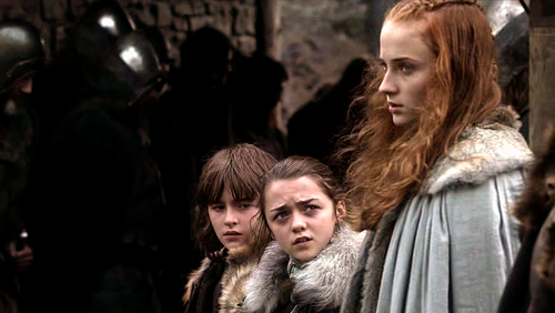 Arya Stark wallpaper containing a fur coat entitled Arya with Sansa and Bran