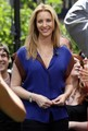 Former 'Friends' star Lisa Kudrow is all smiles as she makes an appearance on TV show 'Extra' at the