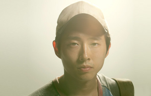 Steven Yeun karatasi la kupamba ukuta probably with an outerwear, a cap, and a kofia titled Glenn
