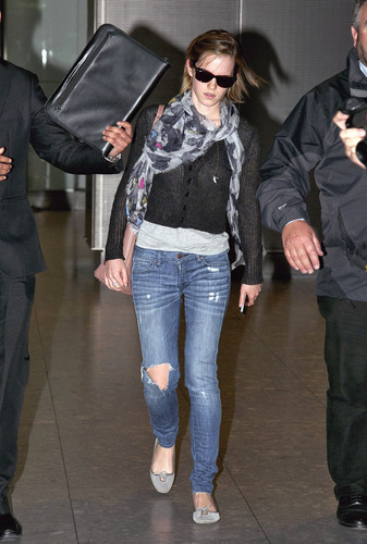 Emma Watson wallpaper possibly with an outerwear, long trousers, and a pantleg called Heathrow Airport, London - 15 June, 2012 - HQ