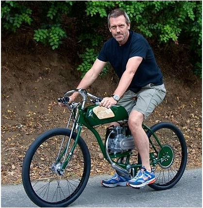 Hugh Laurie on hybrid bike Derringer