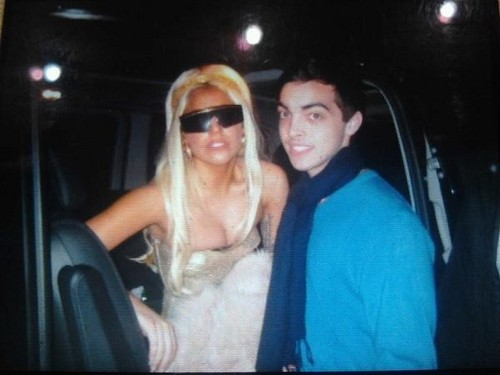 Lady Gaga with a Little Monster in Sydney wearing Versace glasses.