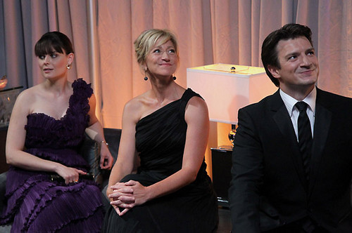 Nathan Fillion 바탕화면 containing a business suit and a bridesmaid called Nathan with Edie Falco & Emily Deschanel