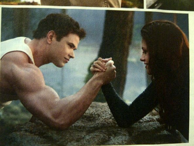 New Breaking Dawn Part 2 still: Bella and Emmett arm wrestling!