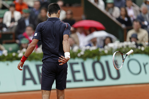 Novak Djokovic throws his racquet in anger, French Open, Roland Garros, Paris, June 10, 2012