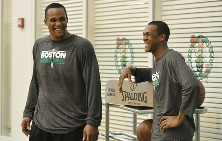 Rajon Rondo wallpaper possibly with a sign and a leisure wear titled Rondo & Glen Davis
