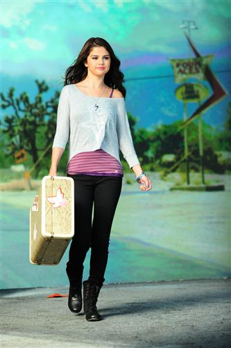 Selena Gomez wallpaper probably containing a hip boot and a well dressed person entitled Selena - Photoshoots 2012 - Dream Out Loud Collection
