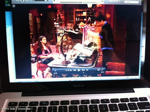 Selena watching WOWP on her laptop