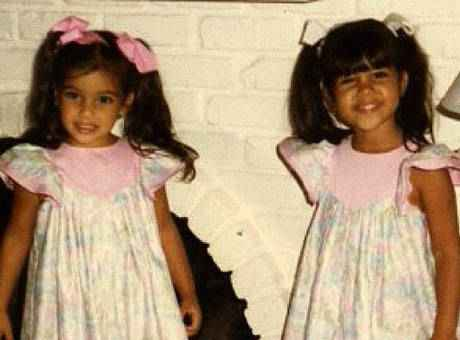 Kim Kardashian wallpaper probably containing a kirtle and a polonaise called baby Kim & Kourtney