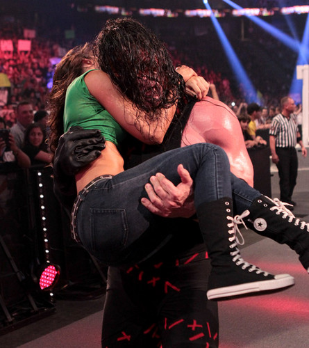 kane and aj - wwe Photo