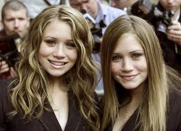 Mary-Kate & Ashley Olsen wallpaper containing a portrait and a business suit titled looking gorgeous