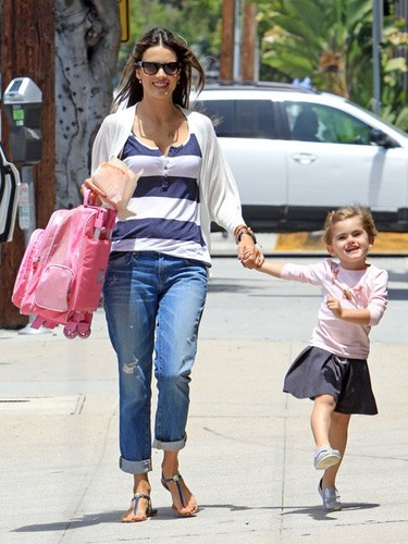Alessandra picking up her daughter Anja after a full dia at school and taking her dog to the vet
