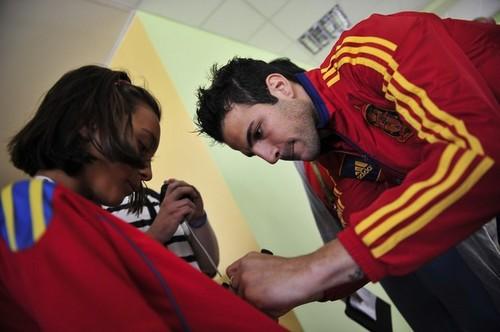 Cesc Fabregas signs an autograph