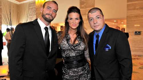 CM Punk wallpaper containing a business suit, a suit, and a three piece suit called Cm  Punk and lita
